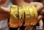 黄金的价格稳中有升:金猪饰品走俏市场