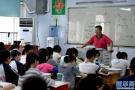 青岛市北区多所学校邀家长当巡考员 增强家校交流