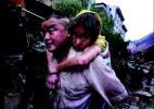 10年前父亲花十几个小时徒手从废墟中刨出女儿 北川女孩长大了!