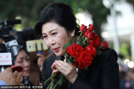Former Thai PM Yingluck celebrates first birthday in exile